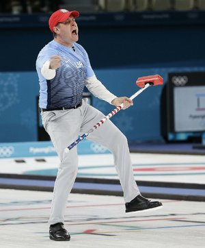 United States skip John Shuster reacts Saturday after making a shot during a 10-7 victory over Sweden to claim the gold medal at the Gangneung Curling Centre in Pyeongchang, South Korea. The Americans used a five-point