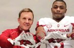 Arkansas Coach Chad Morris and receiver T.Q. Jackson are shown during Jackson's visit to Arkansas in February 2018.