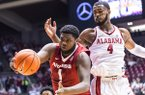 Arkansas forward Trey Thompson Barford (1) grabs a rebound in front of Alabama forward Daniel Giddens (4) during the first half of an NCAA college basketball game Saturday, Feb. 24, 2018, in Tuscaloosa, Ala. (Vasha Hunt/AL.com via AP)