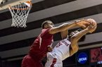 Arkansas forward Daniel Gafford, left, fouls Alabama forward Braxton Key (25) during the second half of an NCAA college basketball game Saturday, Feb. 24, 2018, in Tuscaloosa, Ala. (Vasha Hunt/AL.com via AP)