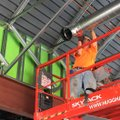 Steve Zimmerman of Northwest Arkansas Sheet Metal works inside the building under construction on th...
