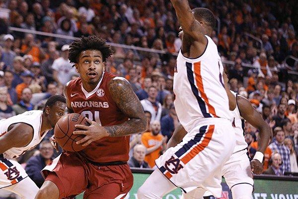 7653121ae90 Arkansas guard Anton Beard drives to the basket against Auburn forward  Horace Spencer during the first