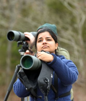 NWA Democrat-Gazette/FLIP PUTTHOFF Pooja Panwar of Fayetteville sees loons through her spotting scope during a visit Jan. 26 2018 to Lake Tenkiller in northeast Oklahoma. The big reservoir attracts flocks of loons and other waterfowl that can be seen during winter and early spring.