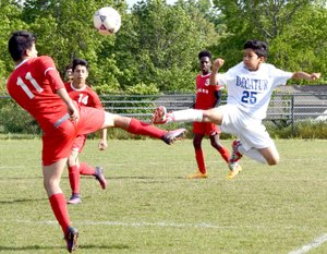 Westside Eagle Observer/MIKE ECKELS Kelvin Moreno (Decatur 25) goes toe to toe with a Tiger player during the May 5, 2017, Decatur-Dardanelle soccer match at Bulldog Stadium in Decatur. The Bulldogs begin their 2018 season March 6 at home against the Life Way Warriors from Centerton.