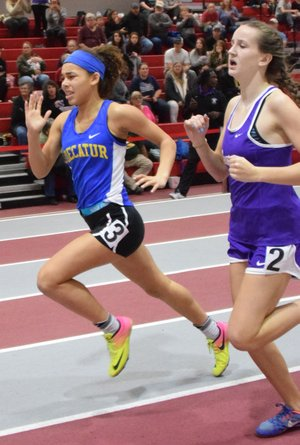 Westside Eagle Observer/MIKE ECKELS Decatur's Desi Meek pushes past another runner on the home stretch of the girls 400-meter run during the Arkansas High School Indoor Track Meet held at the Tyson Indoor Track Complex in Fayetteville Feb. 23.
