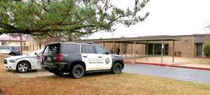 Westside Eagle Observer/RANDY MOLL Gentry police officers and Benton County Sheriff's Office deputies were outside Gentry High School Friday (Feb. 23, 2018) morning to ensure the safety of students and staff following rumors, as yet unsubstantiated, of threats of a school shooting at the high school Friday. Security was also heightened at other Gentry school campuses.