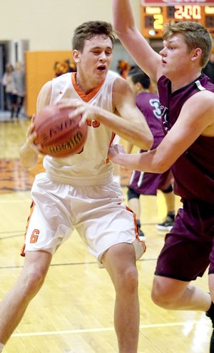 Westside Eagle Observer File Photo/RANDY MOLL Gravette' Dayten Wishon looks to shoot while guared by Gentry's Dylan Kilgore in a game earlier in the season.