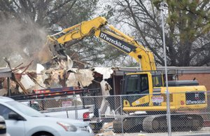 An excavator takes a bite out of the roof of the old Decatur Elementary building in Decatur Feb. 21. The demolition of the old classroom and office area will make way for the new Decatur Middle School gym.
