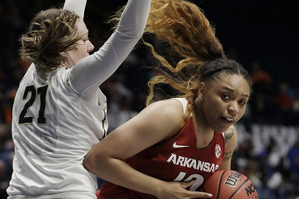 Arkansas' Kiara Williams, right, drives around Vanderbilt's Erin Whalen (21) in the first half of an NCAA college basketball game at the women's Southeastern Conference tournament Wednesday, Feb. 28, 2018, in Nashville, Tenn. (AP Photo/Mark Humphrey)