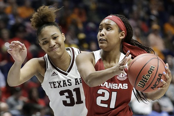 Arkansas guard Devin Cosper (21) drives against Texas A&M forward N'dea Jones (31) in the first half of an NCAA college basketball game at the women's Southeastern Conference tournament Thursday, March 1, 2018, in Nashville, Tenn. (AP Photo/Mark Humphrey)