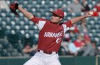 Arkansas pitcher Hunter Milligan throws a pitch during a game against Dayton on Thursday, March 1, 2018, in Fayetteville.