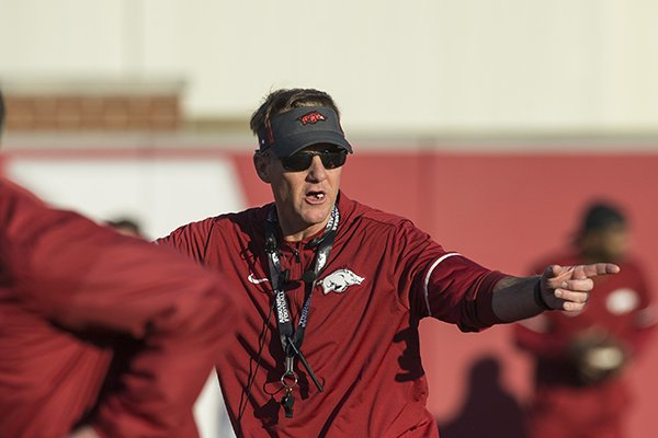 Chad Morris, Arkansas head coach, leads drills Thursday, March 1, 2018, during Arkansas spring football practice at the Fred W. Smith Football Center in Fayetteville.