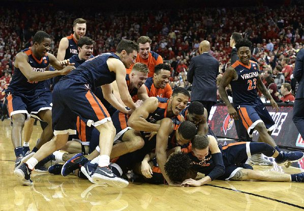 Hunter helps No. 1 Virginia edge Louisville 67-66