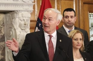 Gov. Asa Hutchinson speaks during a news conference announcing the establishment of a committee to study school safety issues Thursday in Little Rock. Hutchinson named school officials and people with law enforcement backgrounds to the panel in response to last month's school shooting in Florida. (AP Photo/Kelly Kissel)