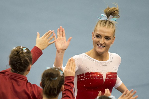 Arkansas Razorbacks Sarah Shaffer high-fives teammates following her performance on the floor during a gymnastics meet, Friday, Jan. 26, 2018, at Barnhill Arena in Fayetteville.