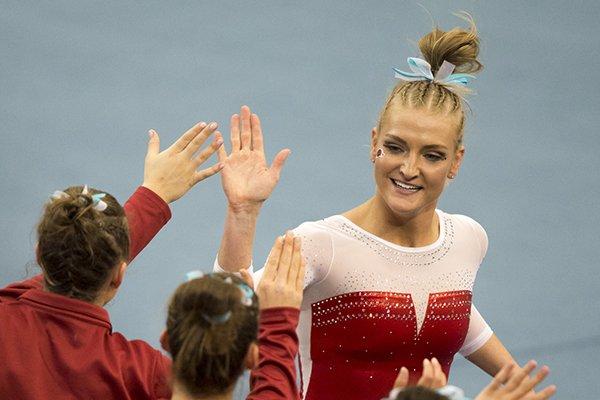 Arkansas Razorbacks Sarah Shaffer high-fives teammates following her performance on the floor during a gymnastics meet, Friday, Jan. 26, 2018, at Barnhill Arena in Fayetteville.