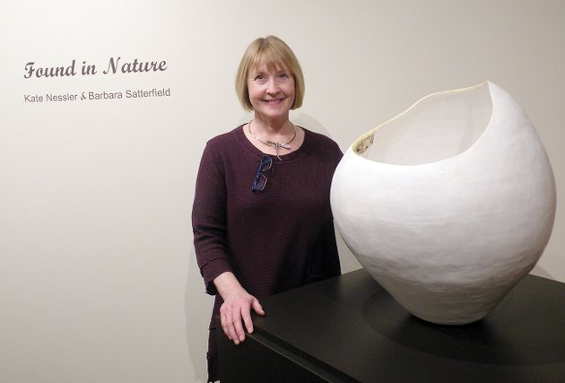 barbara-satterfield-stands-beside-a-very-large-piece-of-her-ceramic-sculpture-she-calls-rim-a-look-on-the-inside-shows-a-press-mold-she-created-from-a-dirt-daubers-nest-the-exhibit-found-in-nature-kate-nessler-and-barbara-satterfield-will-remain-on-display-at-the-historic-arkansas-museum-in-little-rock-until-may-6