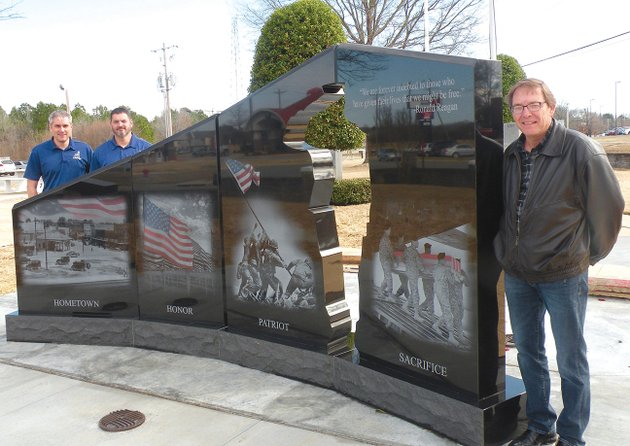 the-community-of-beebe-dedicated-the-gold-star-families-memorial-monument-on-feb-23-in-beebe-veterans-park-showing-one-side-of-the-monument-to-visitors-on-tuesday-are-from-left-jeff-marshall-and-bubba-beason-co-chairmen-of-the-beebe-committee-for-the-gold-star-families-memorial-monument-and-honorary-board-members-of-the-hershel-woody-williams-medal-of-honor-foundation-and-beebe-mayor-mike-robertson