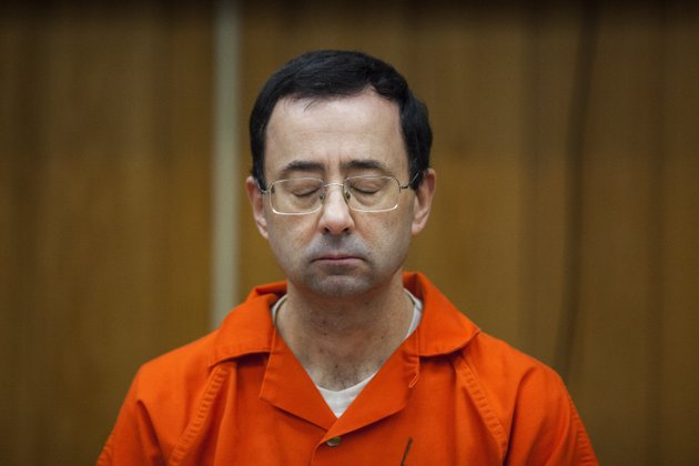 file-in-this-feb-5-2018-file-photo-larry-nassar-listens-during-his-sentencing-at-eaton-county-circuit-court-in-charlotte-mich-right-in-the-midst-of-the-pyeongchang-games-with-hardly-enough-time-for-larry-nassar-to-settle-into-the-prison-cell-where-hell-be-spending-the-rest-of-his-life-we-got-another-report-detailing-horrific-abuse-and-shameful-cover-ups-within-one-of-the-most-high-profile-summer-sports-cory-morsethe-grand-rapids-press-via-ap-file