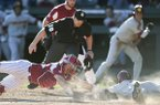 Arkansas catcher Grant Koch tags Southern Cal base runner Chase Bushor during the sixth inning of a game Saturday, March 3, 2018, in Fayetteville.