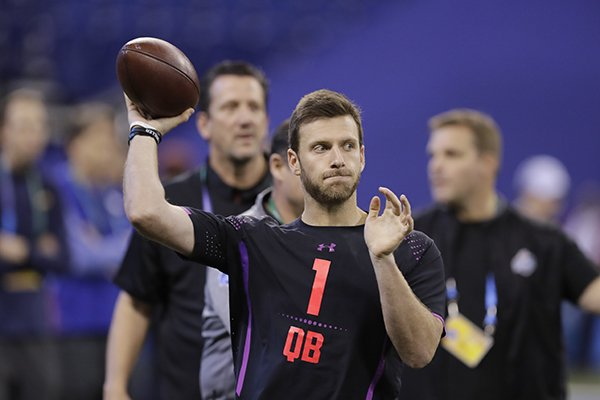 Arkansas quarterback Austin Allen throws during a drill at the NFL football scouting combine, Saturday, March 3, 2018, in Indianapolis. (AP Photo/Darron Cummings)