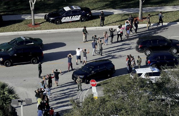 police-lead-students-away-from-marjory-stoneman-douglas-high-school-on-feb-14-after-a-gunman-opened-fire-inside-and-an-on-duty-deputy-failed-to-act-in-arkansas-law-enforcement-departments-say-they-teach-their-officers-that-in-such-cases-the-first-officer-on-the-scene-should-immediately-enter-the-building-and-confront-the-gunman