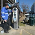 Luke Bouxsein, a parking enforcement officer with Fayetteville, changes a battery Friday on a parkin...