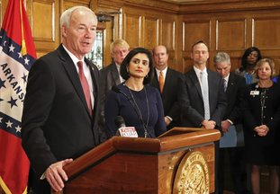 Gov. Asa Hutchinson speaks at a news conference Monday at the state Capitol in Little Rock, Ark., with Seema Verma, the head of the Centers for Medicare and Medicaid Services. Verma on Monday approved a state plan to require that thousands of people on its Medicaid expansion seek ways to work or volunteer. Traditional Medicaid recipients are not affected. Arkansas is the third state to win permission, following Kentucky and Indiana. (AP Photo/Kelly P. Kissel)