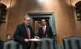 In this Jan. 30 file photo, Senate Banking Committee Chairman Sen. Mike Crapo, R-Idaho, second from left, arrives with Treasury Secretary Steven Mnuchin, right, at the Senate Banking Committee on Capitol Hill in Washington. Ten years after the financial crisis rocked the nation's economy, the Senate is poised to pass legislation that would roll back some of the safeguards Congress put into place to prevent a relapse. The Senate bill emerged from lengthy negotiations between Crapo and Democratic members on the committee. The ranking Democrat, Sen. Sherrod Brown of Ohio, said the changes go too far and he walked away. (AP Photo/Susan Walsh, File)