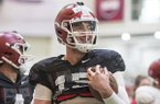 Cole Kelley, Arkansas quarterback, warms up Saturday, March 3, 2018, during Arkansas football spring practice at the Fred W. Smith Football Center in Fayetteville.