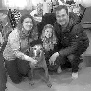 SUBMITTED Red, a dog from the Decatur Animal Shelter, is pictured with his new family in Illinois, thanks to the work of animal rescue organizations like Tailwaggers.