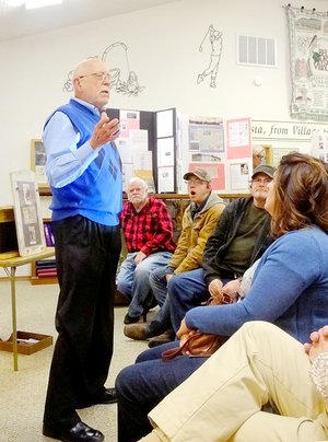 Lynn Atkins/The Weekly Vista Retired college administrator Frank Terry tells a crowd at the Bella Vista Historical Museum about an incident that involved his family in 1857, the Mountain Meadow Massacre.