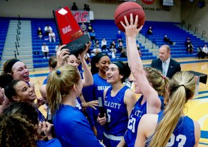 Matthew Christensen/JBU Sports Information Oklahoma City women's basketball players celebrate after winning the Sooner Athletic Conference Tournament on Saturday at Bill George Arena. The defending national champion Stars defeated Science and Arts 89-63.