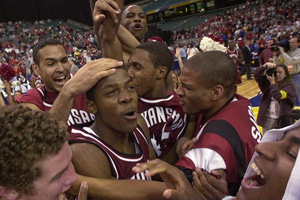 From left Arkansas' Blake Eddins, Dionisio Gomez, Joe Johnson, Brandon Dean, Carl Baker, Larry Satchell and Chris Walker celebrate on the court after beating Auburn 75-67 Sunday, March 12, 2000 in the championship game of the Southeastern Conference Tournament at the Georgia Dome in Atlanta. (AP Photo/Dave Martin)