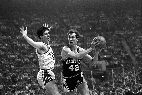 Rick Robey of Kentucky, left, flails his arms as Jim Counce (42) of Arkansas tries to pass during semifinal NCAA action in St. Louis, Mo., March 25, 1978. (AP Photo)