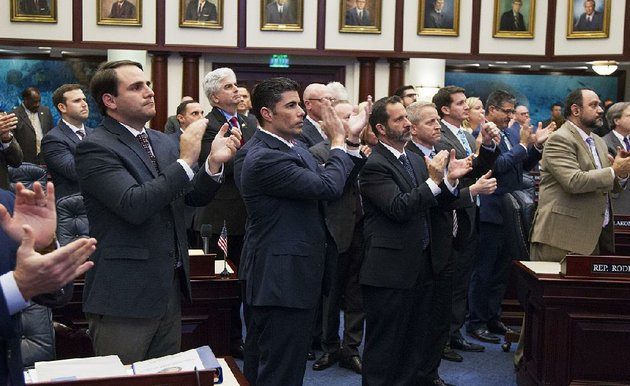 house-sponsor-jose-oliva-second-from-left-is-joined-by-fellow-florida-state-representatives-wednesday-in-applauding-andrew-pollack-father-of-18-year-old-meadow-pollack-after-passing-the-school-safety-bill-meadow-pollack-was-among-the-victims-in-the-feb-14-shooting-at-marjory-stoneman-douglas-high-school