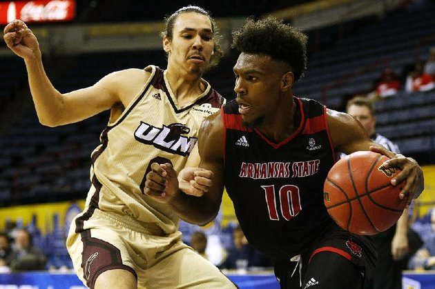 arkansas-state-guard-grantham-gillard-10-dribbles-round-louisiana-monroe-guard-brandon-newman-during-the-second-half-of-the-red-wolves-76-54-loss-wednesday-at-the-sun-belt-conference-tournament-in-new-orleans