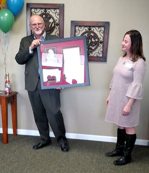 """Courtesy photo Paul G. Taylor, who serves as chief executive officer of the OCH Health System, accepts an award honoring his efforts to help the """"working poor"""" and underserved who need healthcare in southwest Missouri. Taylor was recently recognized as Missouri's Rural Health Champion for 2017."""