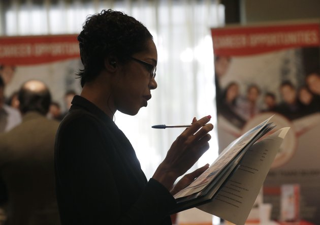 in-this-tuesday-jan-30-2018-photo-joana-dudley-of-lauderhill-fla-looks-at-her-list-of-job-prospects-at-a-jobnewsusa-job-fair-in-miami-lakes-fla-on-wednesday-march-7-2018-payroll-processor-adp-reports-how-many-jobs-private-employers-added-in-february-ap-photolynne-sladky