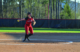 Strikeout queen Camden Fairview junior pitcher and infielder Lexi Betts throws a pitch during a recent road game against Magnolia. Betts ended the game with an impressive total of 10 strikeouts.