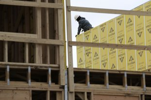 In this Feb. 26 photo, work continues on a new development in Fair Lawn, N.J. On Friday, the Labor Department reported that U.S. employers added 313,000 jobs in February, the most in any month since July 2016, and drawing hundreds of thousands of people into the job market. (AP Photo/Seth Wenig, File)