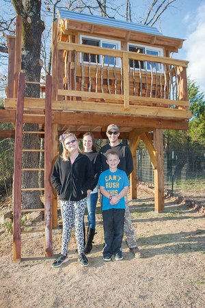 Allisa Carter, 11, of Searcy is a Make-A-Wish recipient of a treehouse. Carter, a Southwest Middle School student, has tuberous sclerosis complex, a rare genetic condition. Pictured are, front, from left, Alissa and her brother, Brandon, 8; and back, their parents, Ashley and Robert Carter.