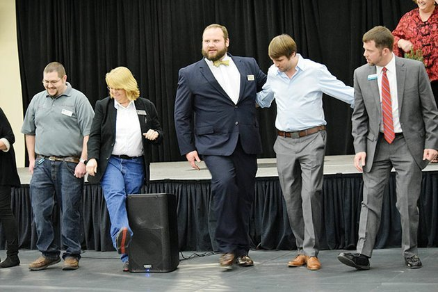 heber-springs-area-chamber-of-commerce-board-members-from-left-ryan-sartin-toi-logan-jeremy-bivins-cody-davis-and-brett-graham-take-part-in-the-boardwalk-auction-during-the-2017-chamber-banquet
