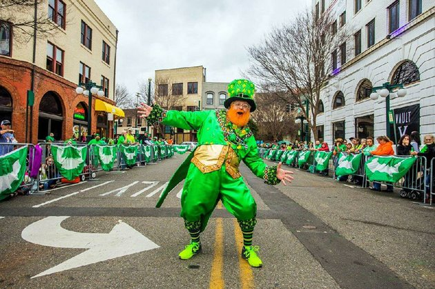 monte-everhart-the-worlds-tallest-leprechaun-dances-at-last-years-worlds-shortest-st-patricks-day-parade-his-activities-for-the-day-include-a-vip-lunch-for-sponsors-and-celebrity-guests-a-blarney-stone-kissing-contest-officially-measuring-the-parade-route-and-pre-parade-interaction-with-the-crowd-everhart-says-he-has-met-attendees-from-korea-finland-and-england-and-many-from-surrounding-states