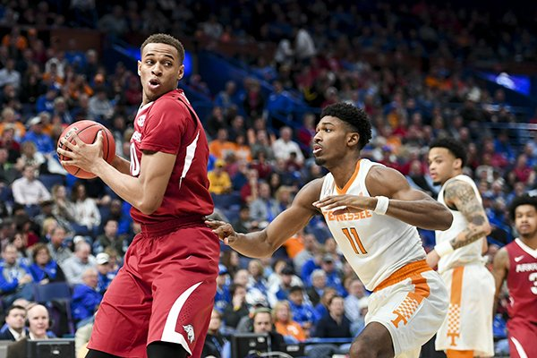 Arkansas' Daniel Gafford (10) turns against Tennessee's Kyle Alexander (11) during an SEC Tournament game Saturday, March 10, 2018, in St. Louis.