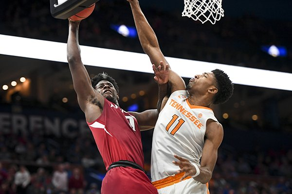 Arkansas guard Jaylen Barford (0) goes up for a layup against Tennessee forward Kyle Alexander (11) during an SEC Tournament game Saturday, March 10, 2018, in St. Louis.