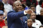 Arkansas head coach Mike Anderson gestures during the first half of an NCAA college basketball game against Tennessee in the semifinals of the Southeastern Conference tournament Saturday, March 10, 2018, in St. Louis. (AP Photo/Jeff Roberson)
