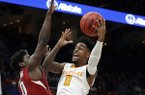 Tennessee's Jordan Bone, center, heads to the basket as Arkansas' Jaylen Barford, left, and Daniel Gafford defend during the first half of an NCAA college basketball game in the semifinals of the Southeastern Conference tournament Saturday, March 10, 2018, in St. Louis. (AP Photo/Jeff Roberson)