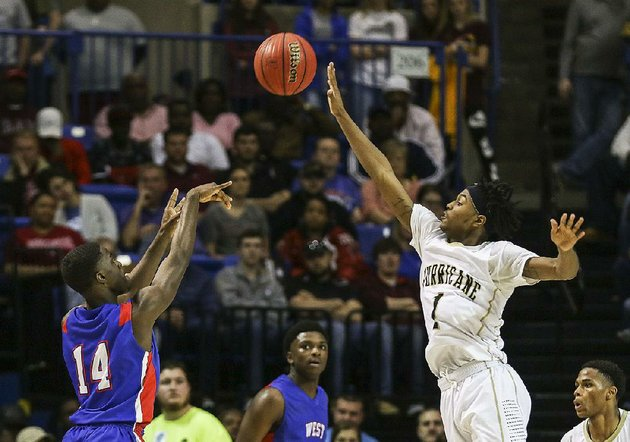 jonesboros-tony-hutson-right-blocks-a-shot-by-clemith-prackett-of-west-memphis-during-the-hurricanes-55-49-victory-over-the-blue-devils-in-the-class-6a-boys-state-championship-game-saturday-in-hot-springs