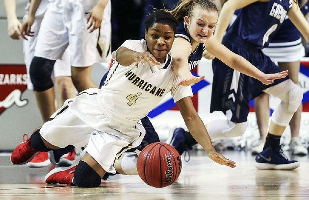 jonesboros-kayla-mitchell-front-and-greenwoods-kinley-fisher-scramble-for-a-loose-ball-saturday-during-the-lady-hurricanes-57-44-victory-over-the-lady-bulldogs-in-the-class-6a-girls-state-championship-game-at-bank-of-the-ozarks-arena-in-hot-springs